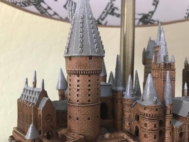 Harry Potter Hogwarts Lamp from The Bradford Exchange: close-up of the details of one of the towers, including multiple windows and visible bricks