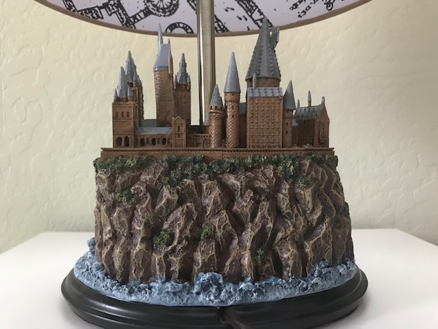 Harry Potter Hogwarts Lamp from The Bradford Exchange: far view of the details of one of the towers, including multiple windows and visible bricks