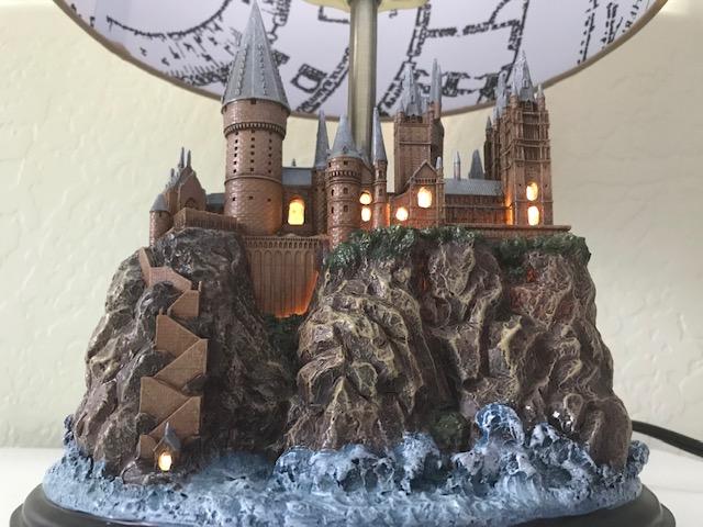 Harry Potter Hogwarts Lamp Illuminated Base: front view of the Hogwarts castle sculpture base illuminated