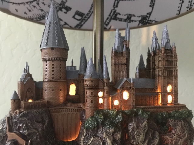 Harry Potter Hogwarts Lamp Illuminated Base: close-up view of the front of the castle with the windows illuminated