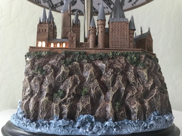 Harry Potter Hogwarts Lamp Illuminated Base: view of the back of the Hogwarts castle sculpture base with the windows illuminated