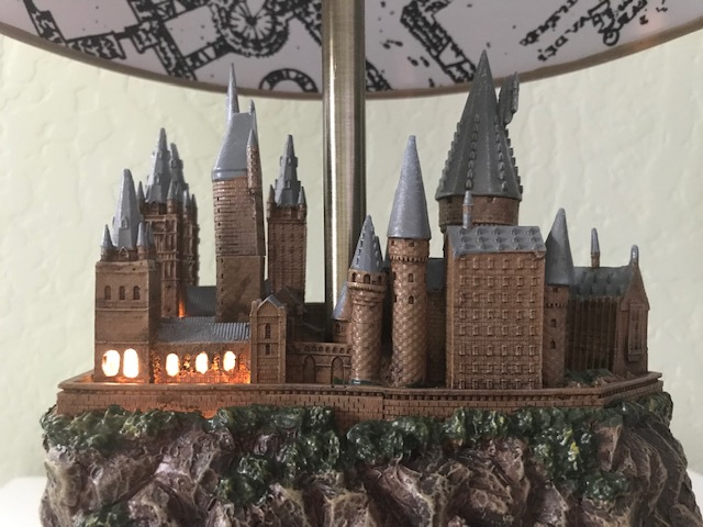 Harry Potter Hogwarts Lamp Illuminated Base: Close-up view of the castle from the back with the windows illuminated