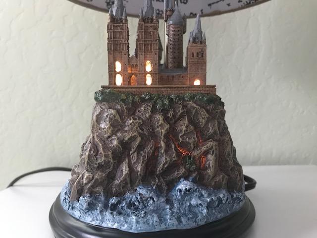 Harry Potter Hogwarts Lamp Illuminated Base: right side view with the Hogwarts castle sculpture base illuminated