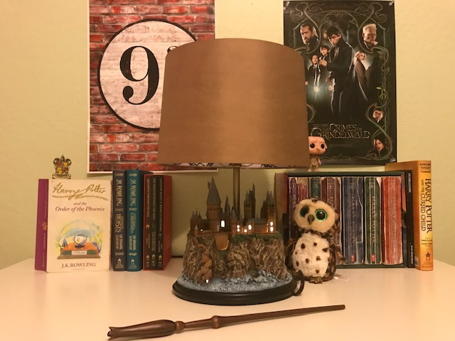 Harry Potter Hogwarts Lamp from The Bradford Exchange: pictured with other Harry Potter collectibles and books, Hogwarts castle base windows illuminated