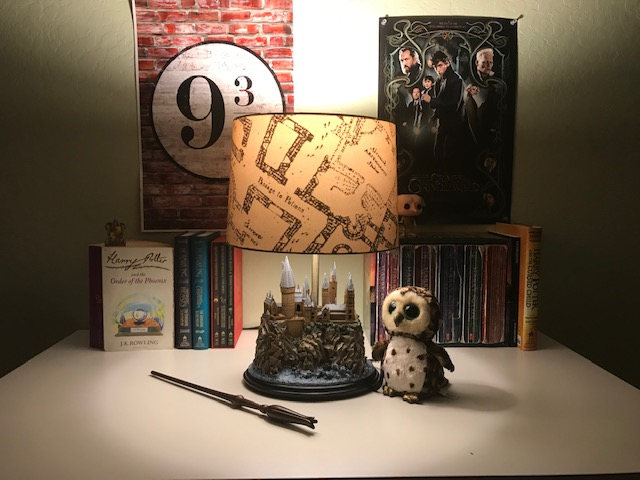 Harry Potter Hogwarts Lamp from The Bradford Exchange: pictured with other Harry Potter collectibles and books, Marauder's Map lampshade illuminated