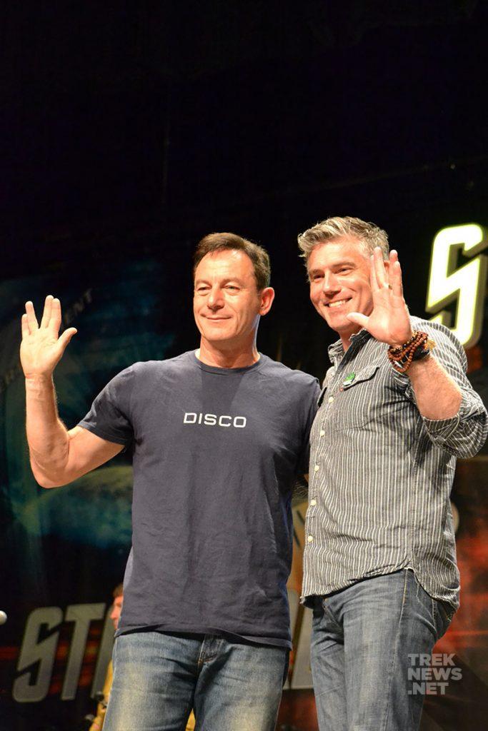 Jason Isaacs gives the Vulcan salute alongside Anson Mount.