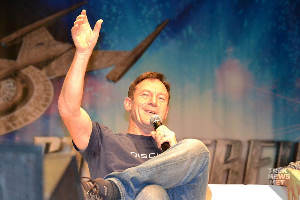 Jason Isaacs laughs during a panel at Star Trek Vegas.