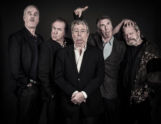 John Cleese poses with fellow Pythons Eric Idle, Terry Jones, Michael Palin, and Terry Gilliam.