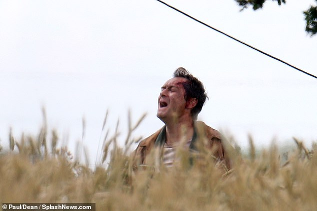"Jude Law shouts in despair during filming for ""The Third Day""."
