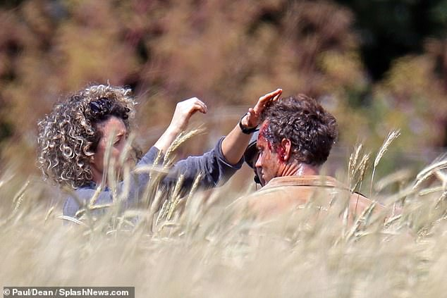 "A hairstylist makes sure Jude Law looks disheveled enough during filming for ""The Third Day""."