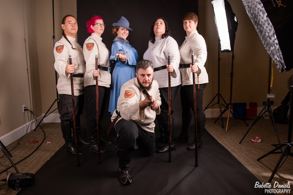 Durmstrang and Beauxbatons cosplayers pose in the photo booth.