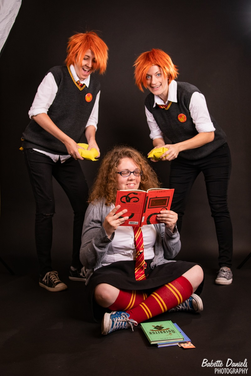 Fred and George pester Hermione with whoopee cushions while she's trying to study.