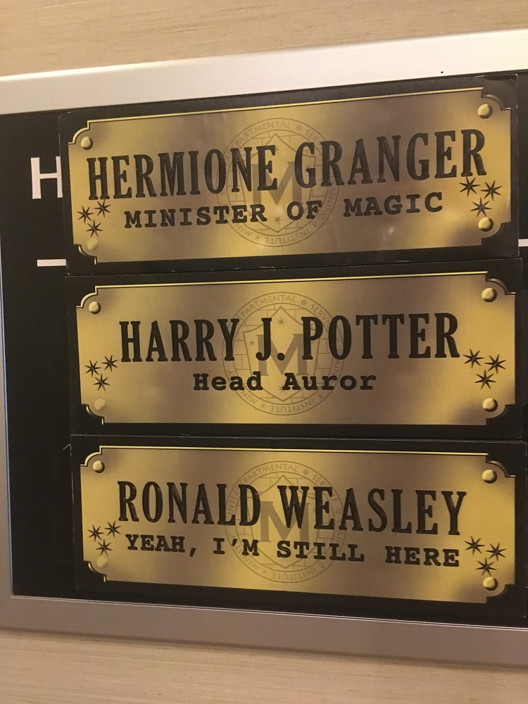 Harry's, Ron's, and Hermione's Ministry of Magic nameplates