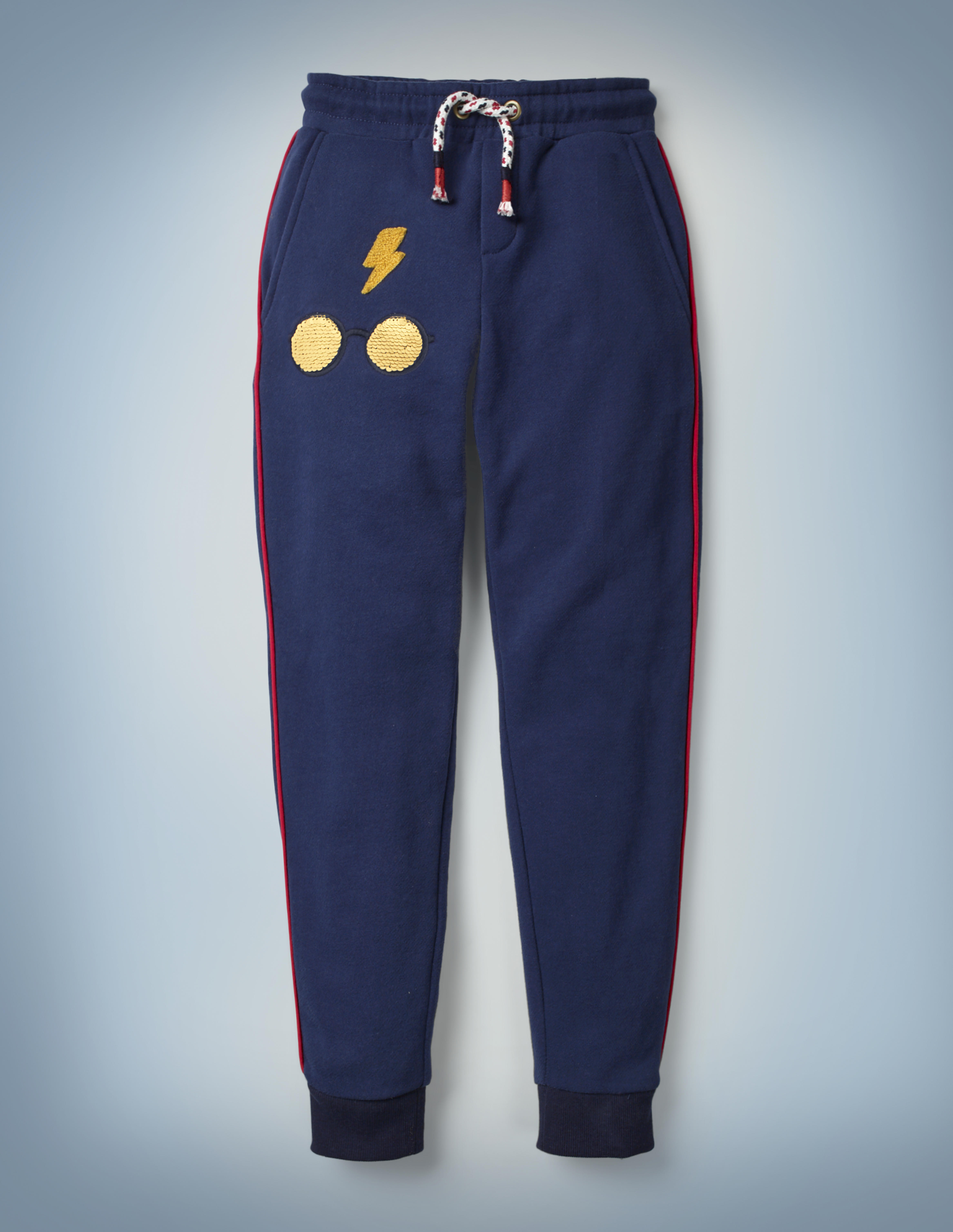 The Mini Boden Transfiguration Sequin Joggers in blue come with a drawstring waist and design featuring Harry Potter's iconic glasses and lightning bolt scar. They retail at £26.