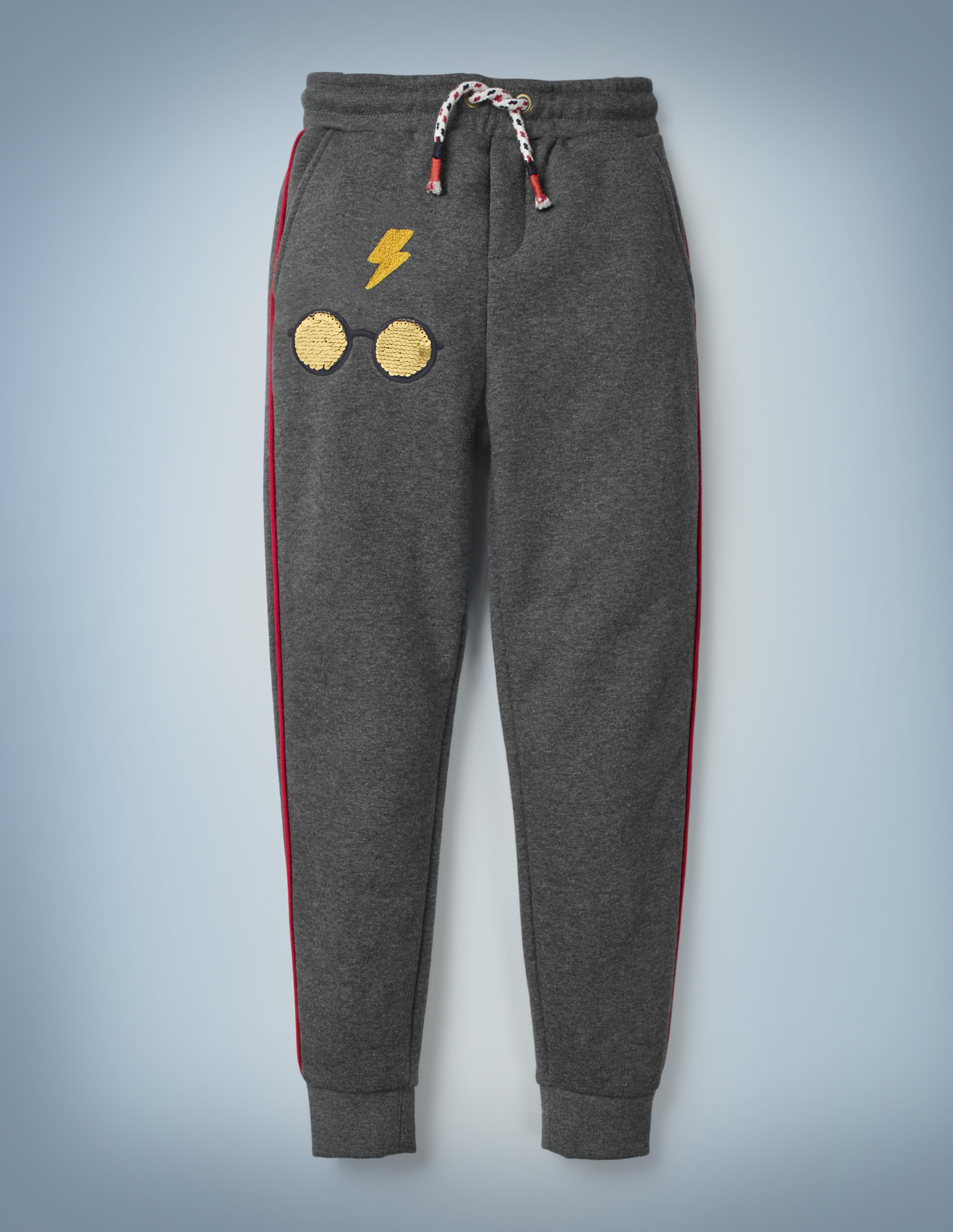 The Mini Boden Transfiguration Sequin Joggers in gray come with a drawstring waist and design featuring Harry Potter's iconic glasses and lightning bolt scar. They retail at £26.