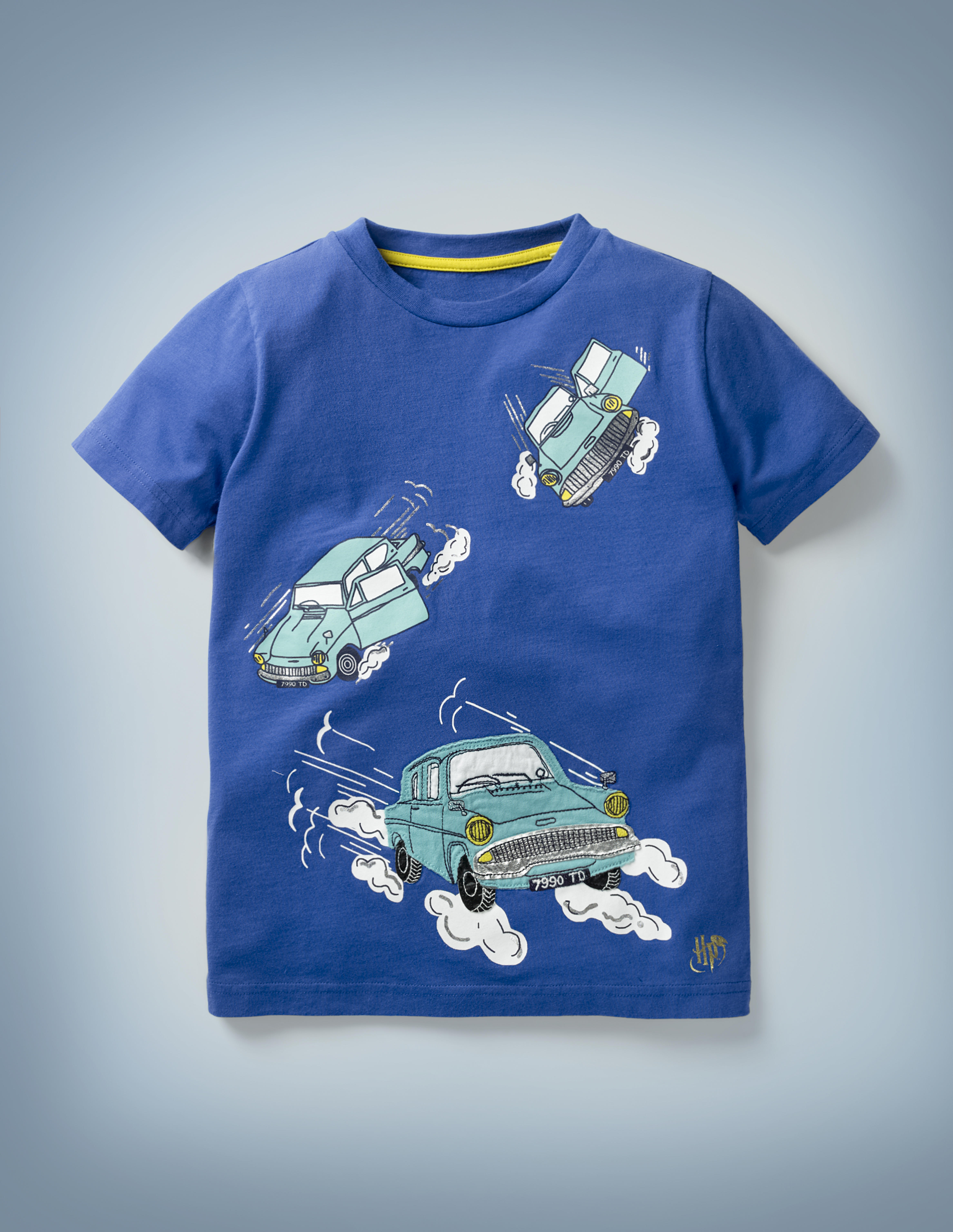 The Mini Boden Magical Transport T-shirt in blue features a fun design that includes three illustrations of Arthur Weasley's flying Ford Anglia making its way through the sky. It retails at £20.