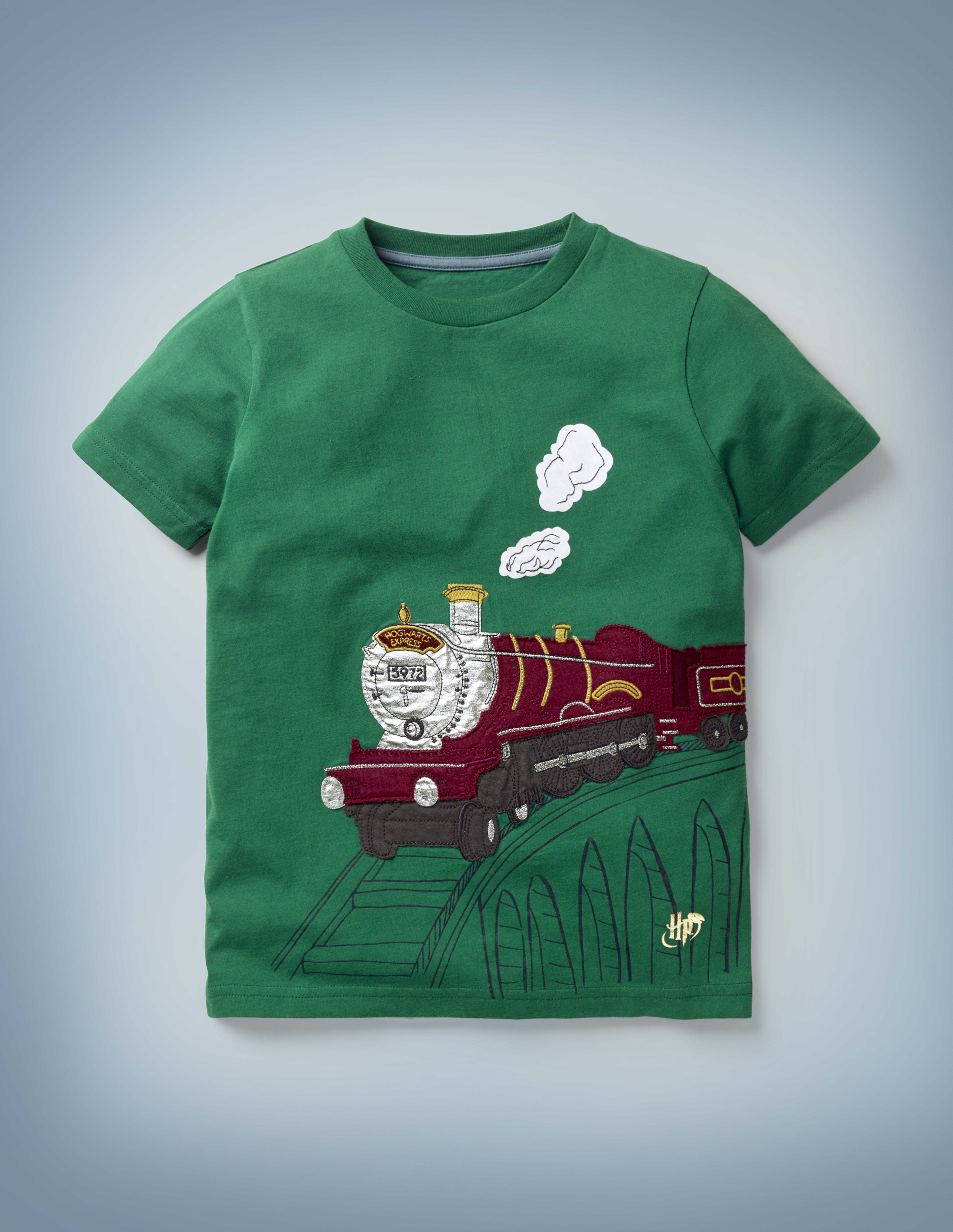 The Mini Boden Magical Transport T-shirt in green boasts a textured graphic of the Hogwarts Express chugging its way over the railway viaduct. It retails at £20.