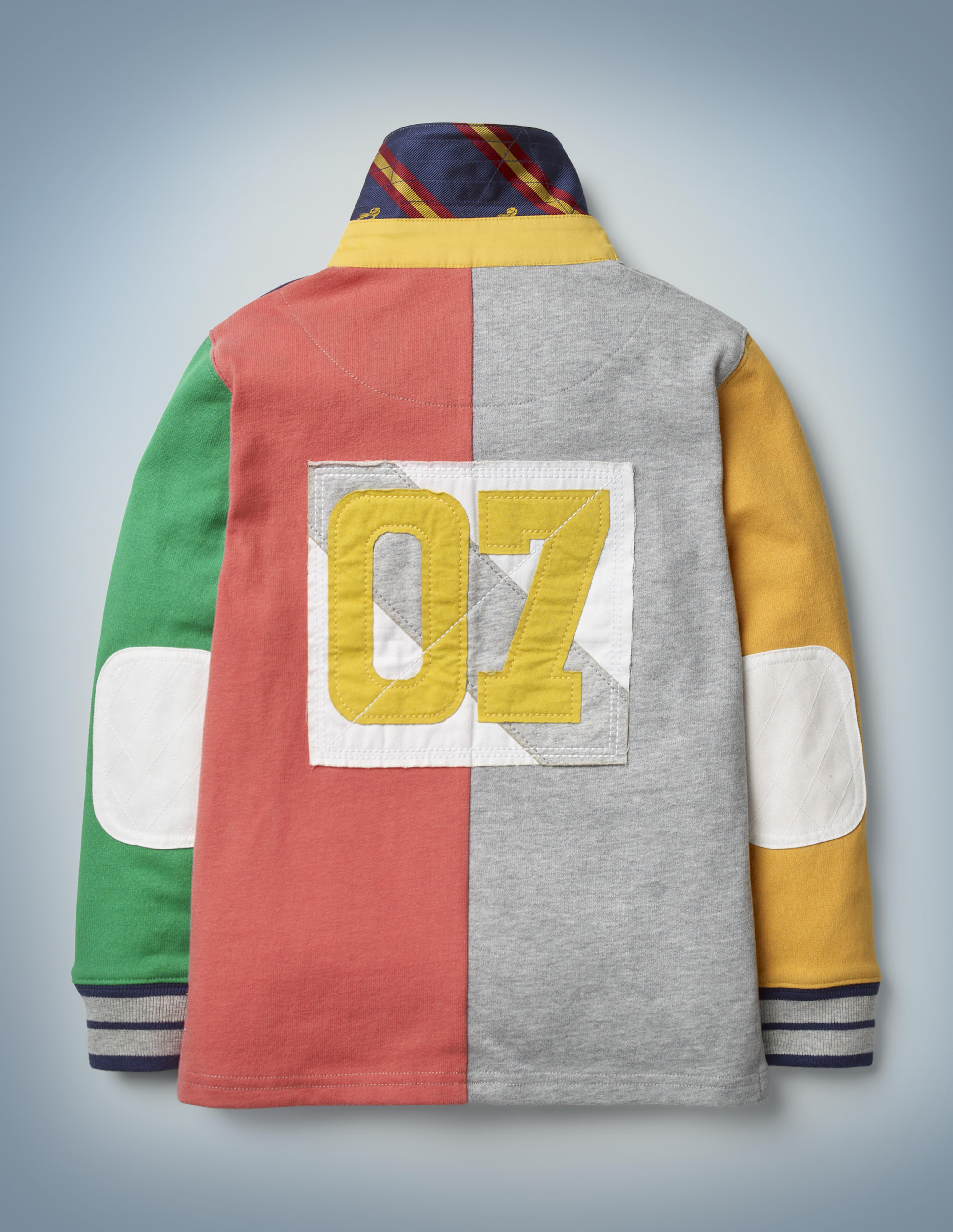 This view of the back of the Mini Boden Hogwarts Rugby Shirt, multi-color, shows a patch featuring Harry Potter's Quidditch number: 07. It retails at £30.