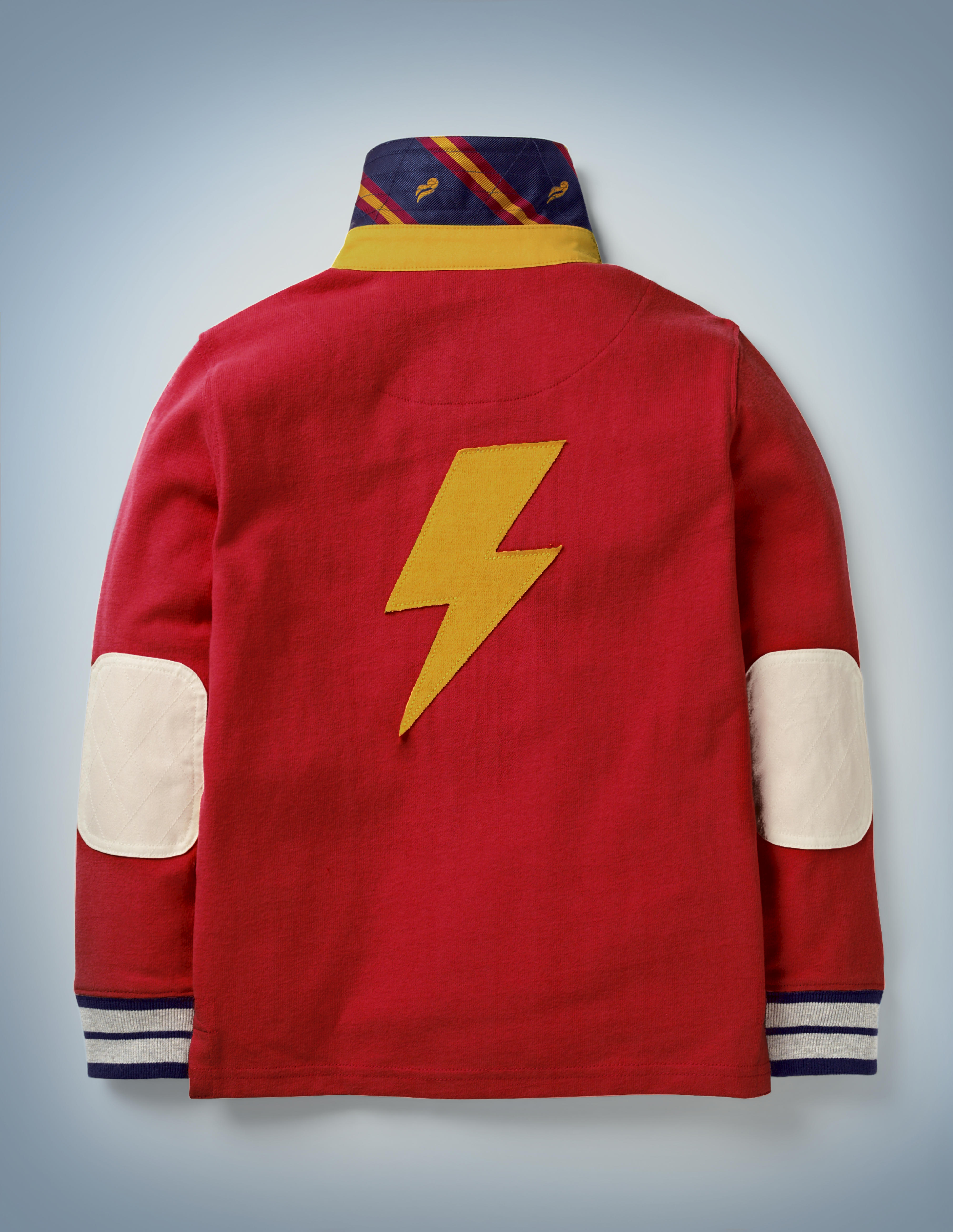 This view of the back of the Mini Boden Hogwarts Rugby Shirt in red showcases a large lightning bolt design. It retails at £30.