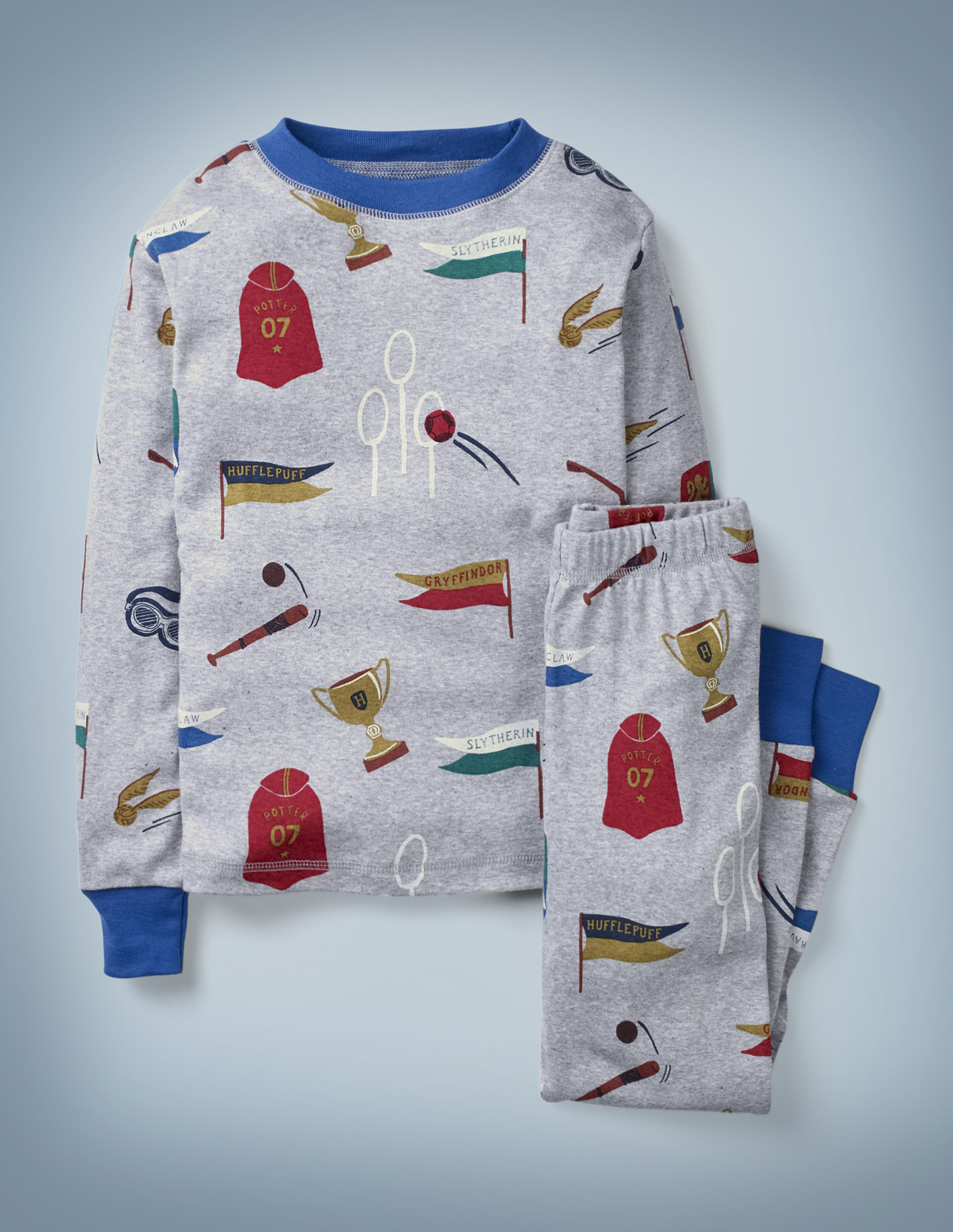 The Mini Boden Harry Potter Long John Pyjamas in gray feature all-over images of Quidditch-related items, including a Quaffle flying through the hoop, a Golden Snitch, a Quidditch Cup, and more. The top-and-bottom set retails at £24.