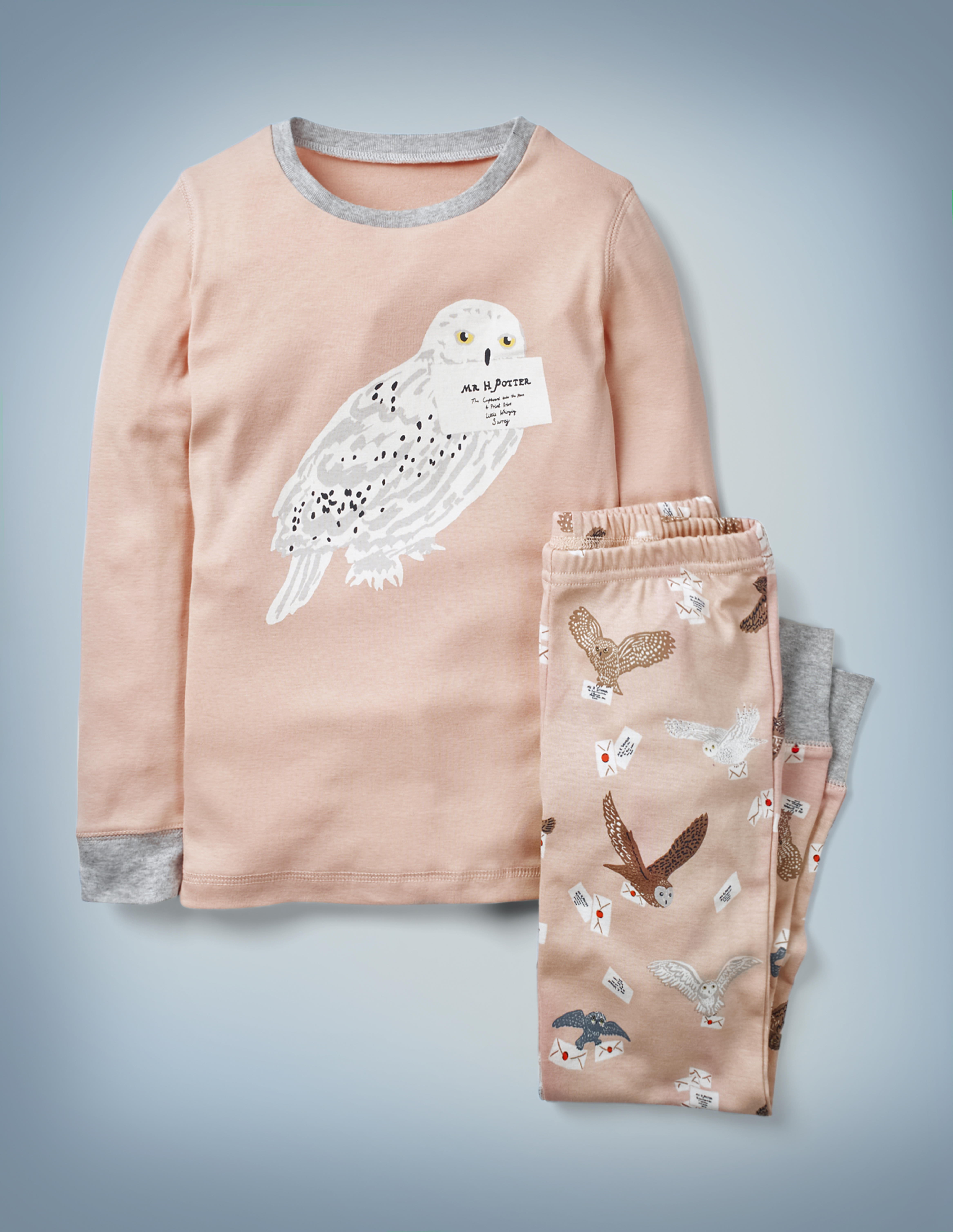 The Mini Boden Harry Potter Long John Pyjamas in pink feature all-over images of owls delivering Hogwarts acceptance letters on the pants and a large central image of Hedwig with Harry Potter's acceptance letter in her beak on the long-sleeved top. The top-and-bottom set retails at £24.
