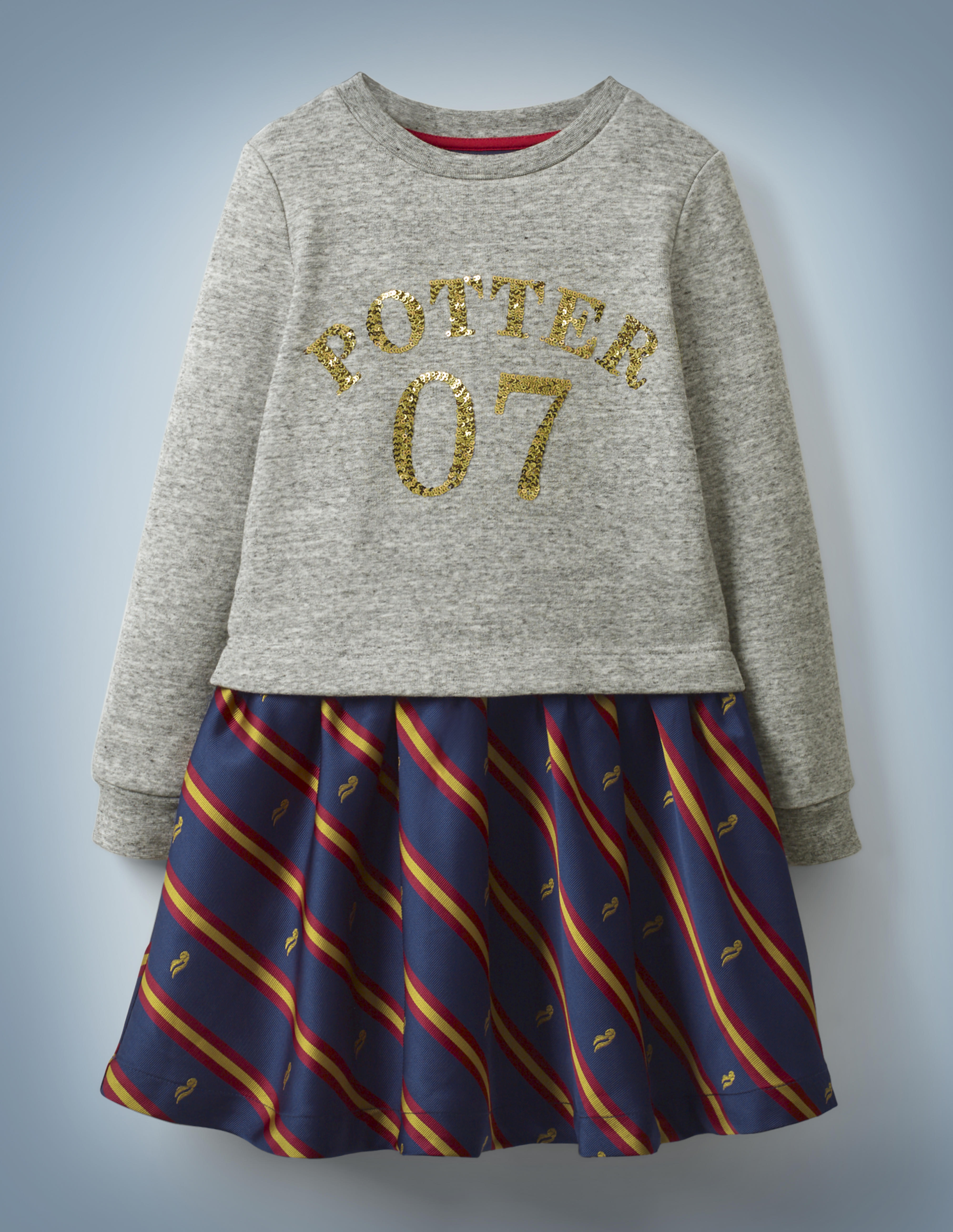 """The Mini Boden Sequin Seeker Dress resembles a skirt and top and features a heather gray, long-sleeved top with gold sequins reading """"Potter 07"""" and blue skirt bottom with red-and-gold stripes and Golden Snitches. It retails at £35."""