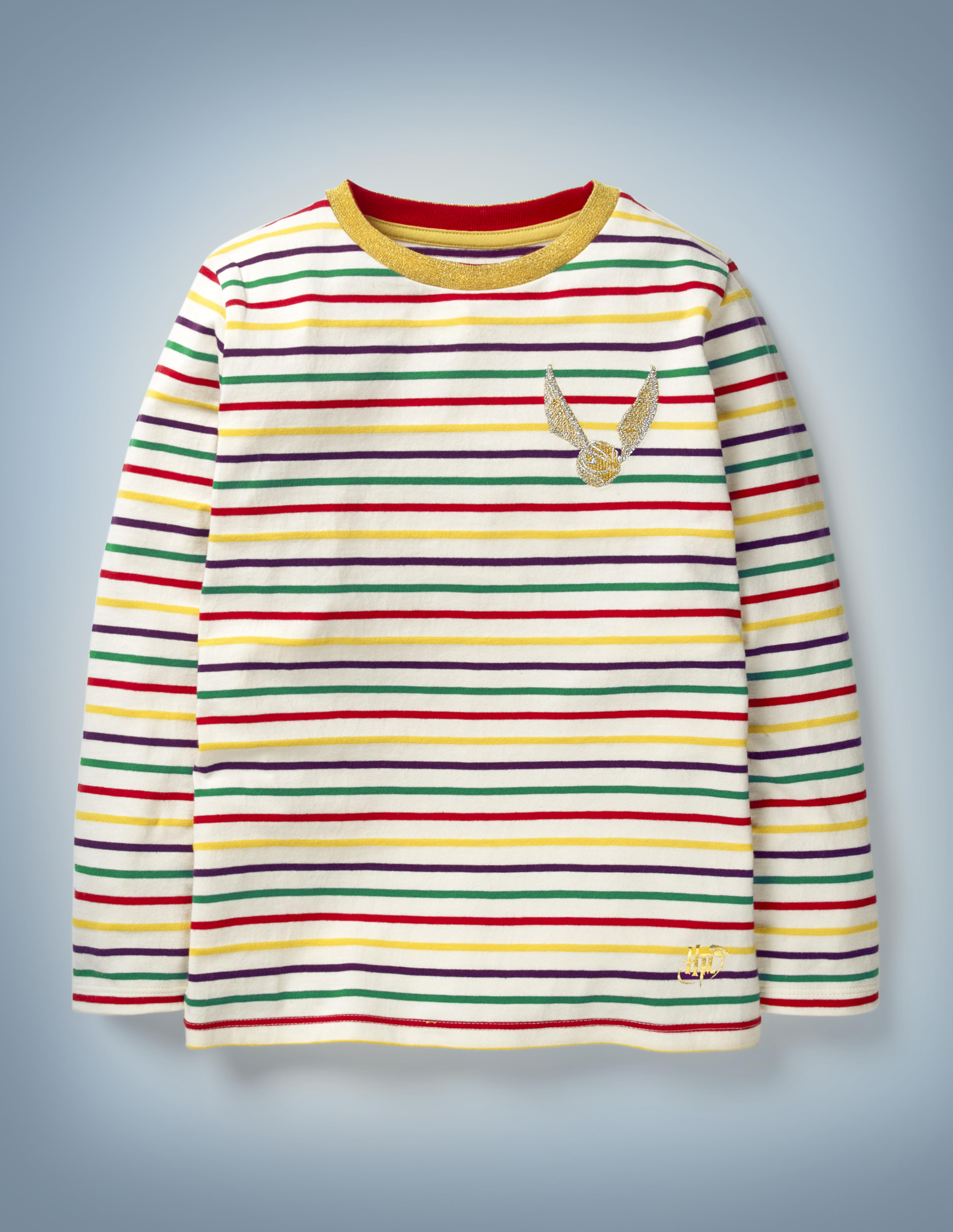 The Mini Boden Golden Snitch Breton, multi-color, features all-over stripes in Hogwarts House colors between white and an image of a Golden Snitch in the front pocket area. It retails at £20.