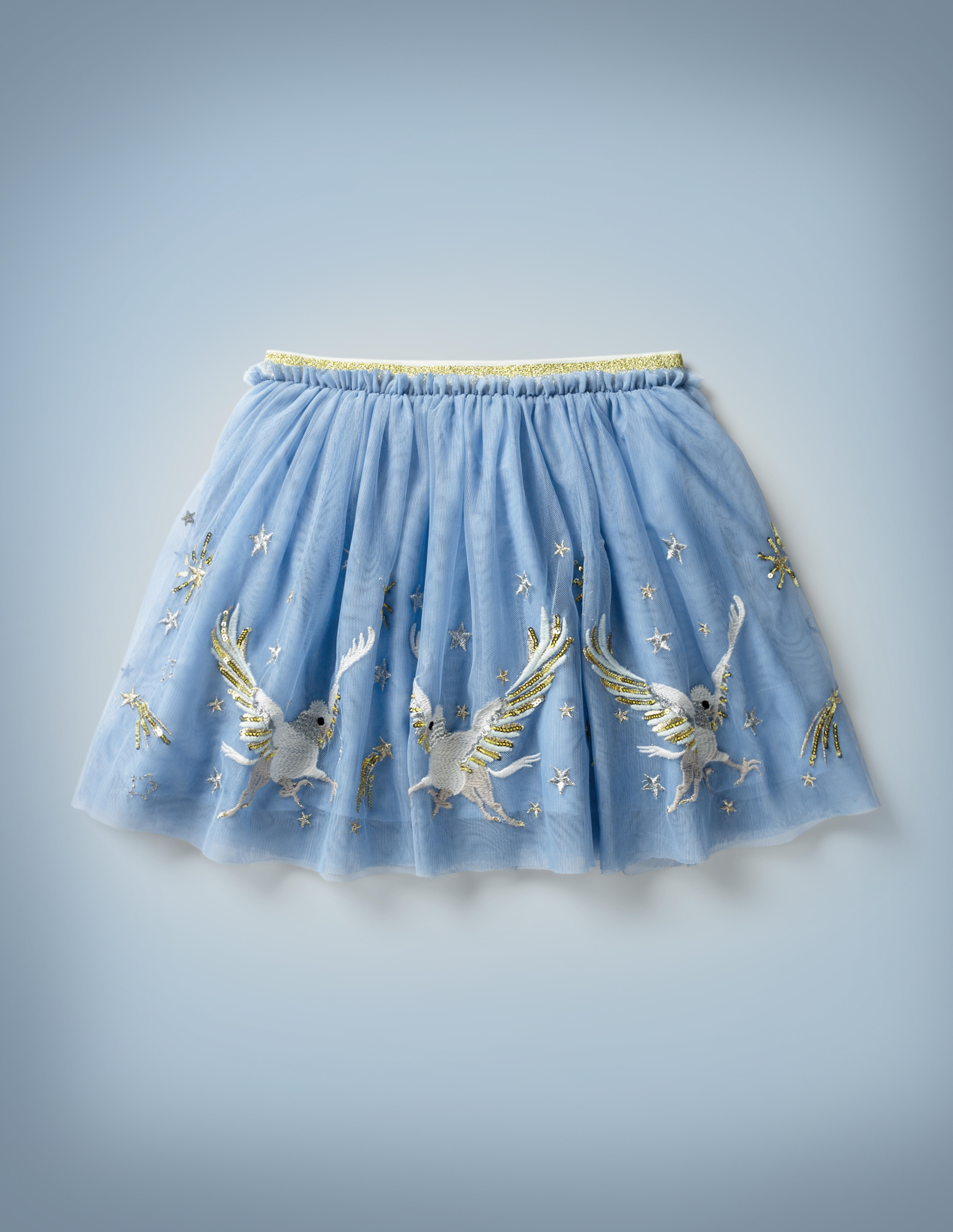 The Mini Boden Hippogriff Tulle Skirt in light blue features a large, repeating design of a hippogriff flying among the stars near its hem. It retails at £40.