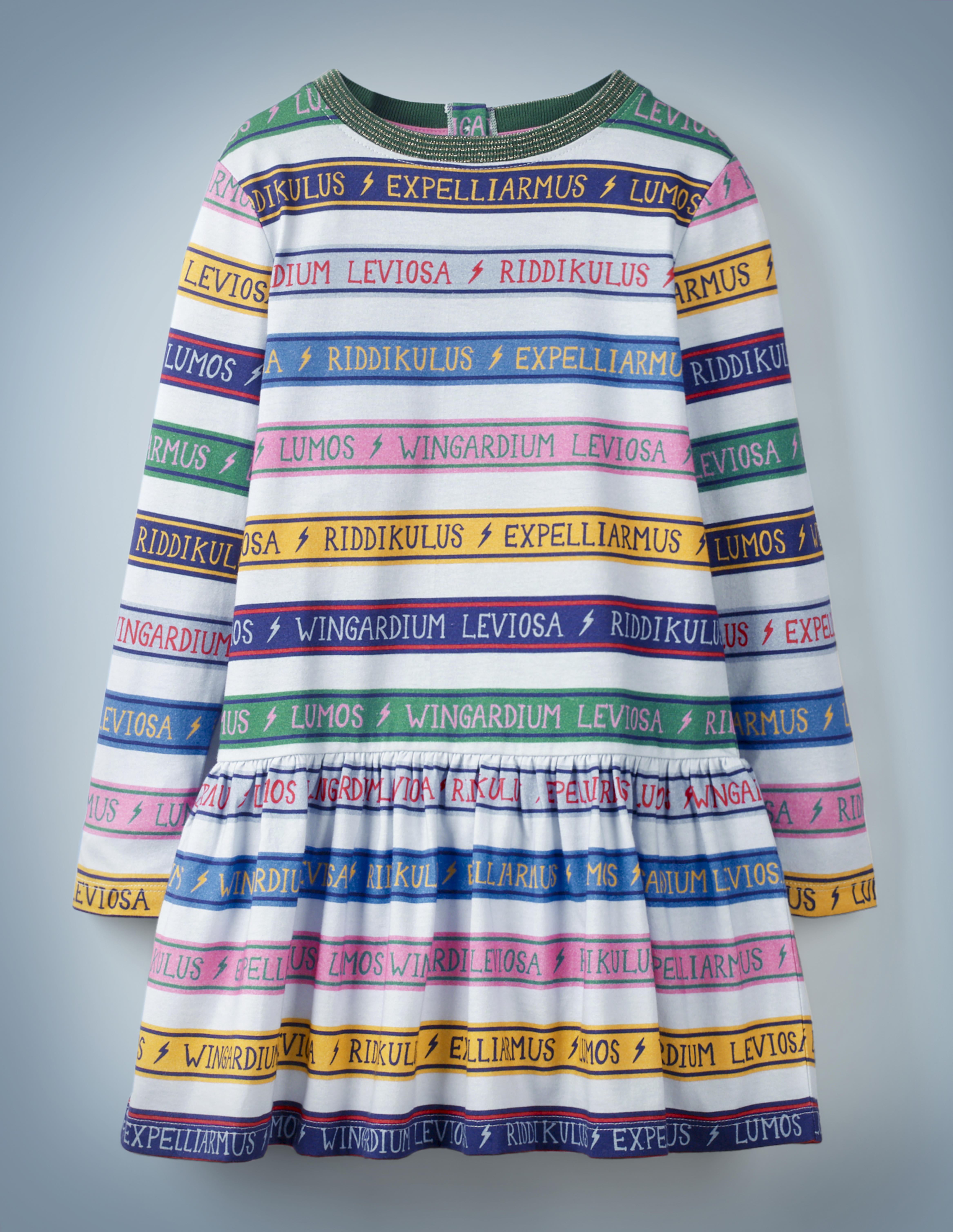 """The Mini Boden Charms Class Stripe Dress, multi-color, features alternating white and colored stripes. The colored stripes include spell incantations separated by lightning bolts, including """"Wingardium Leviosa,"""" """"Riddikulus,"""" """"Expelliarmus,"""" and """"Lumos."""" It retails at £28."""