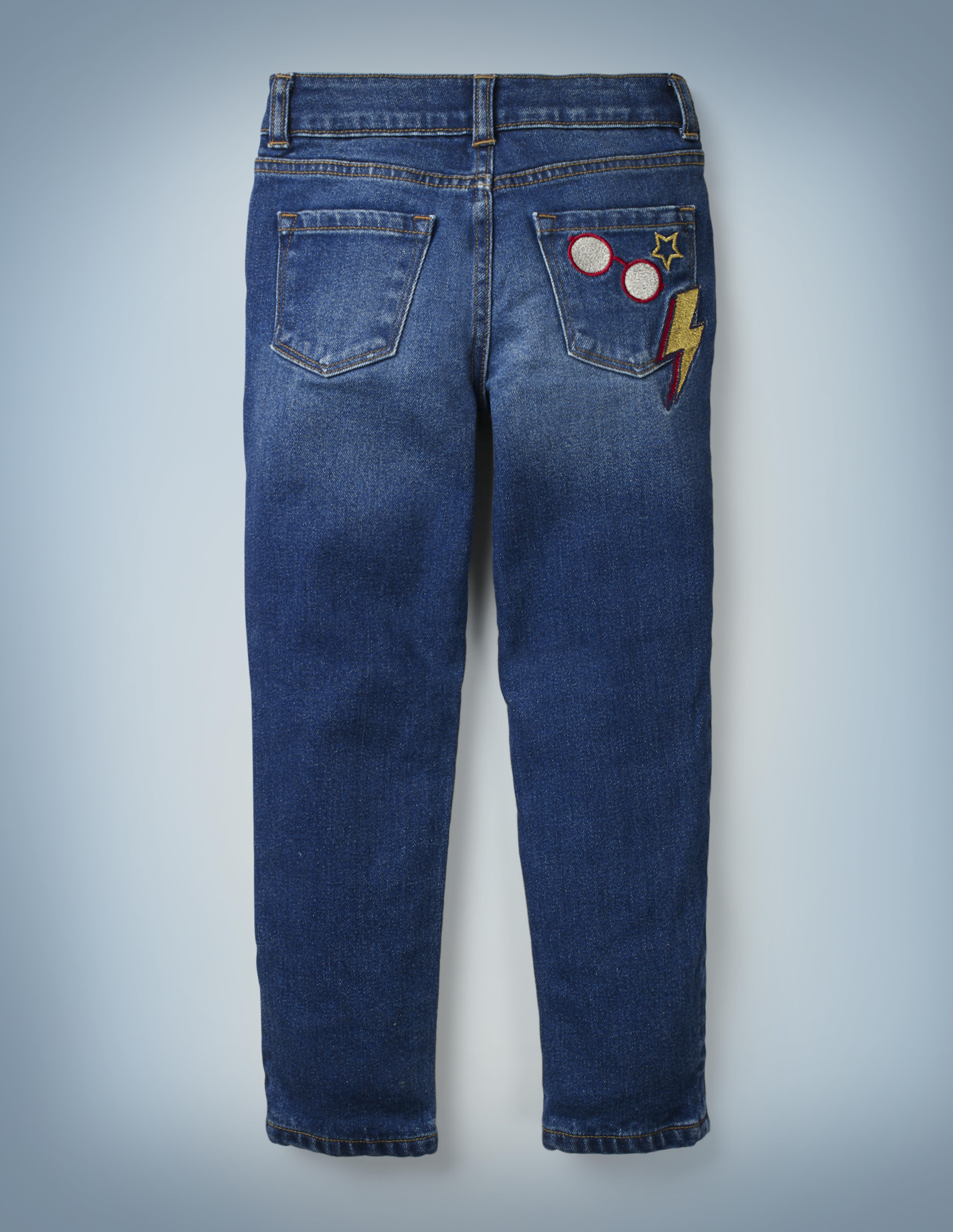 The Mini Boden Lightning Bolt Jeans include a fun design of Harry Potter's glasses, a red-and-gold lightning bolt, and a star on the back right pocket. They retail for £28.