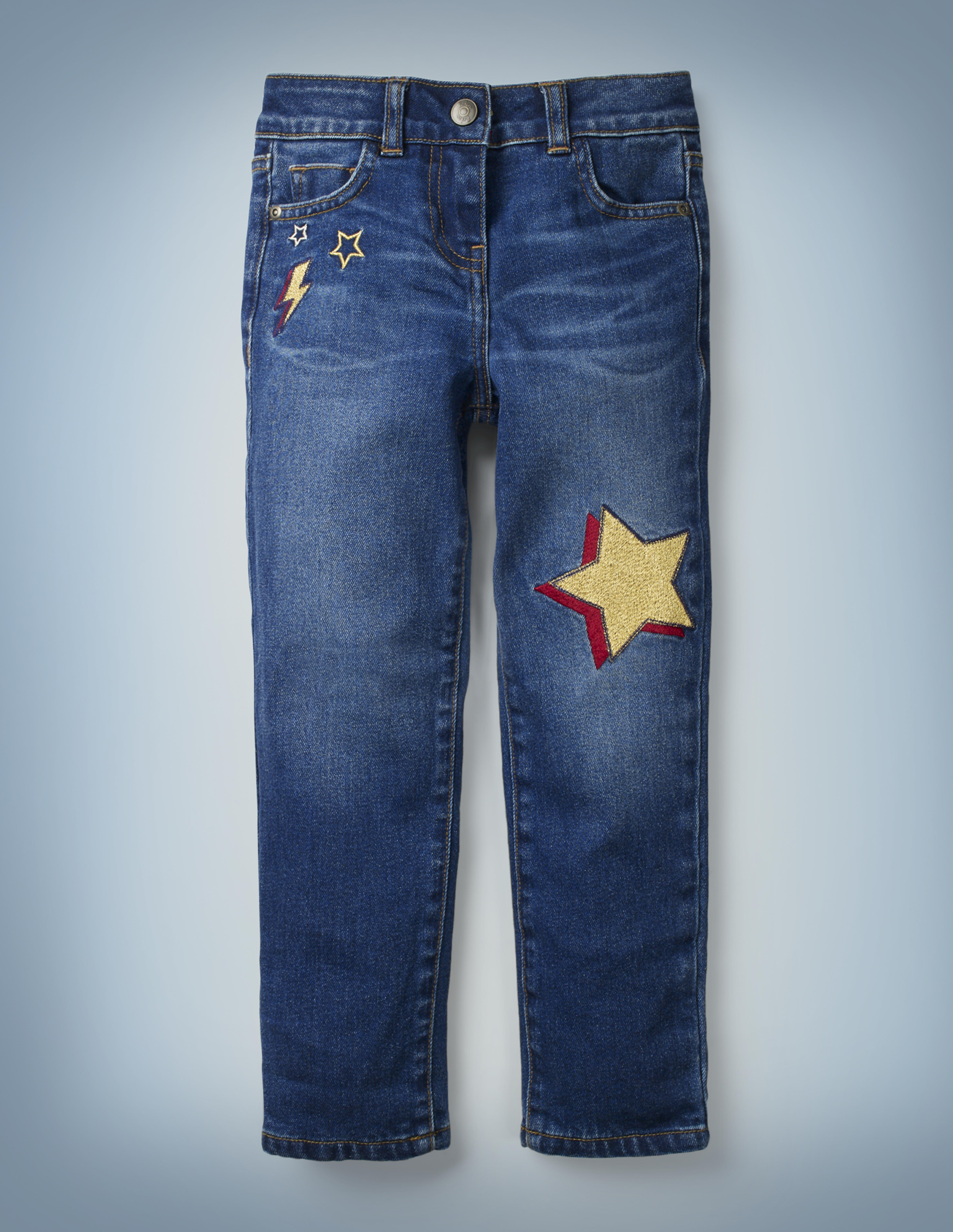 The Mini Boden Lightning Bolt Jeans include a fun design of stars and a red-and-gold lightning bolt near the right front pocket and a red-and-gold star in the left knee area. They retail for £28.