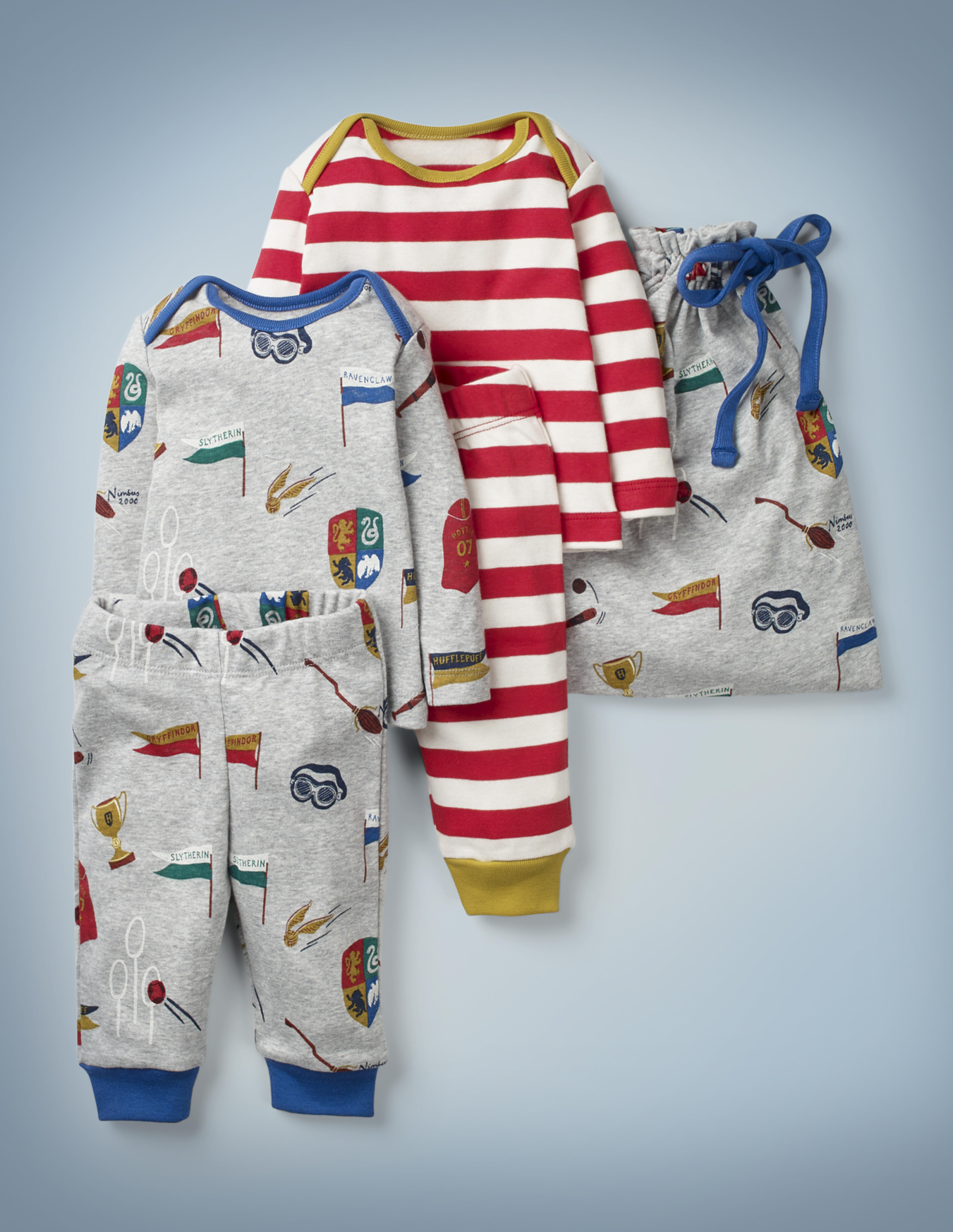 The Mini Boden Harry Potter Play Set, multi, features two top-and-bottom play outfits – one gray and featuring all-over images of Quidditch-related items, one with all-over red-and-white stripes and gold collar and pant cuffs – and a gray drawstring bag featuring Quidditch items. It retails between £35 and £38.