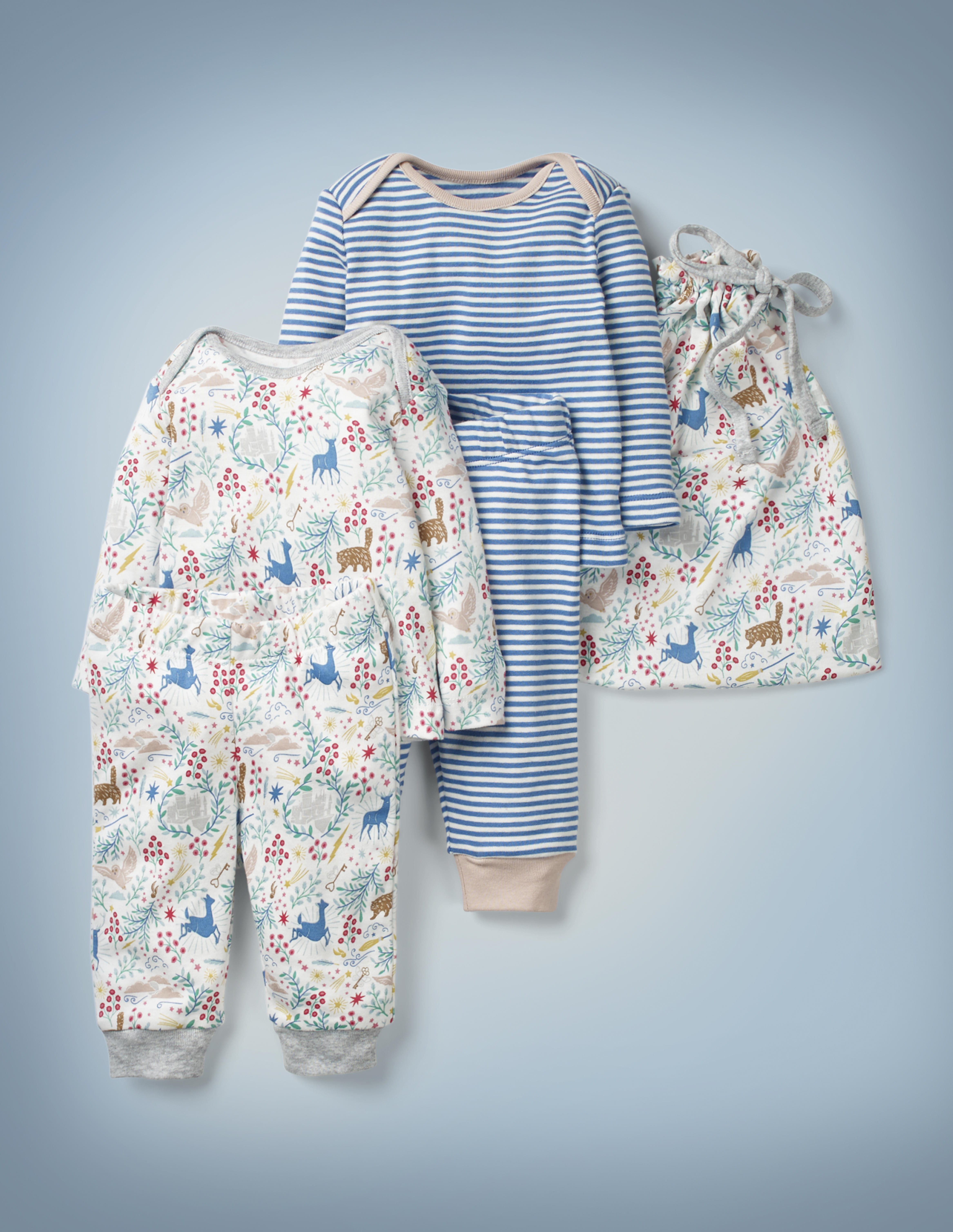 The Mini Boden Harry Potter Play Set, ivory, features two top-and-bottom play outfits – one with all-over blue-and-white stripes, one white with all-over images including Crookshanks, Hedwig, a stag, and a doe – and a drawstring bag in the latter design. It retails between £35 and £38.