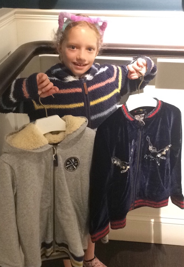 Picking one favorite item from the collection was difficult, so Rosie decided to show off her two must-have pieces.