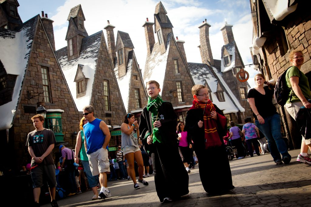 A pair of young wizards make their way through Hogsmeade at the Wizarding World of Harry Potter at Universal Orlando Resort.