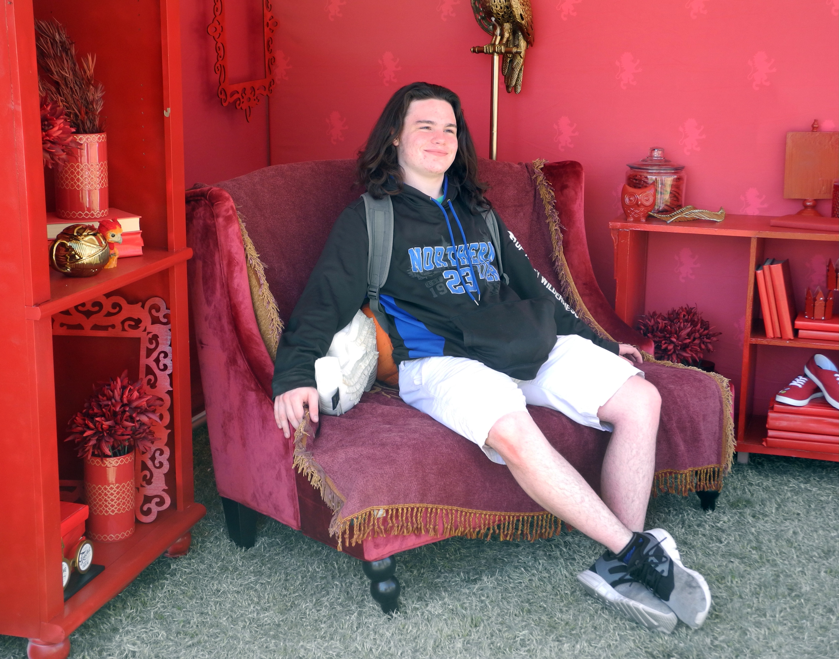 A Gryffindor student from the University of Arizona kicks back on the couch in his House's miniature common room.