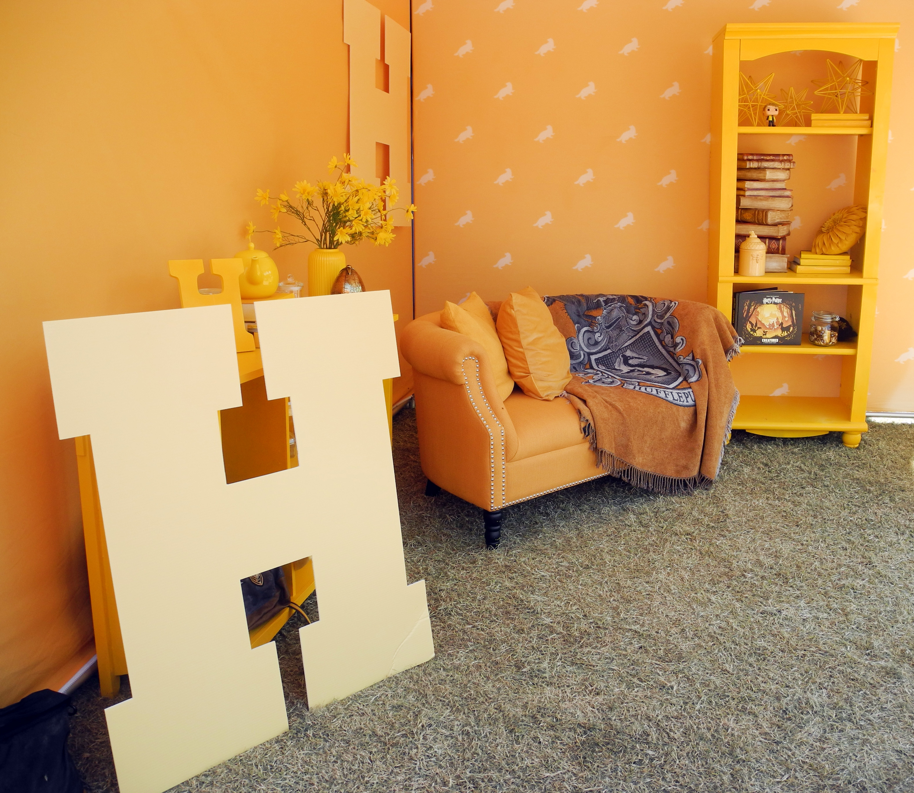A miniature Hufflepuff common room looks cozy and inviting during a Back to Hogwarts event at the University of Arizona.