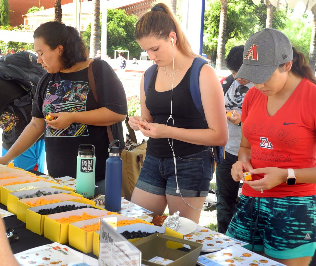 University of Arizona students work to construct Golden Snitches from LEGO bricks during a Back to Hogwarts event.