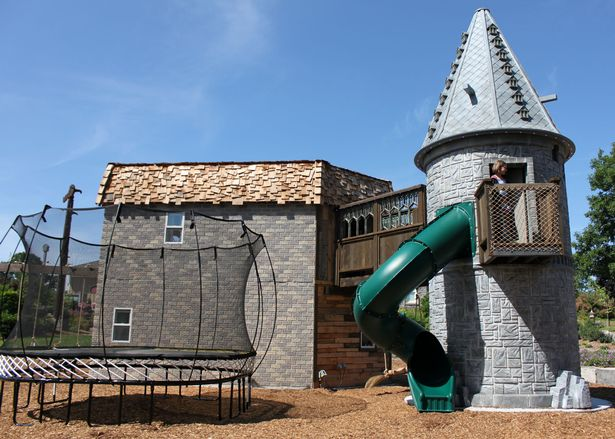 The slide descending from the playhouse's tower