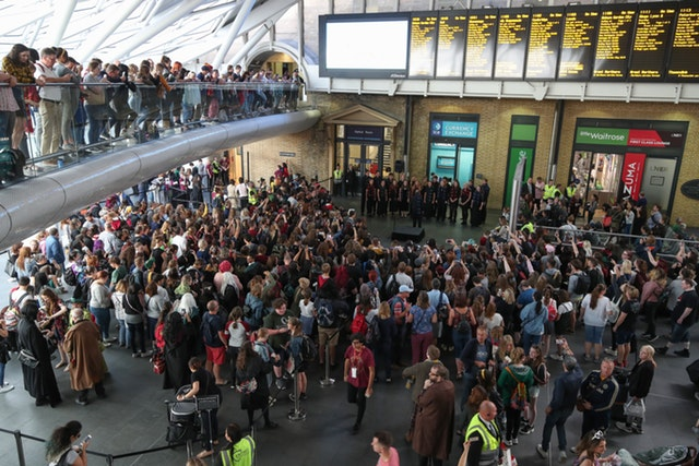 The crowd gathered at King's Cross in London for Back to Hogwarts Day awaits the countdown to 11 a.m.