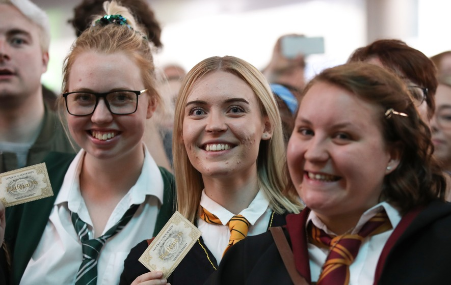 Slytherin, Hufflepuff, and Gryffindor students have their Hogwarts Express tickets at the ready at King's Cross in London.