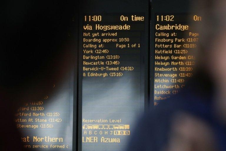 "The departure board at King's Cross displays a listing for ""Edinburgh via Hogsmeade."""