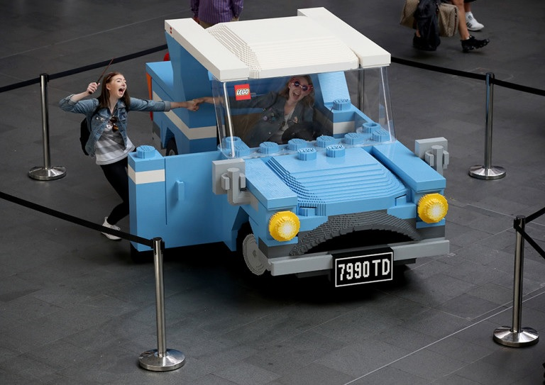 Fans enjoy a life-size Ford Anglia constructed from LEGO bricks on Back to Hogwarts Day at King's Cross.