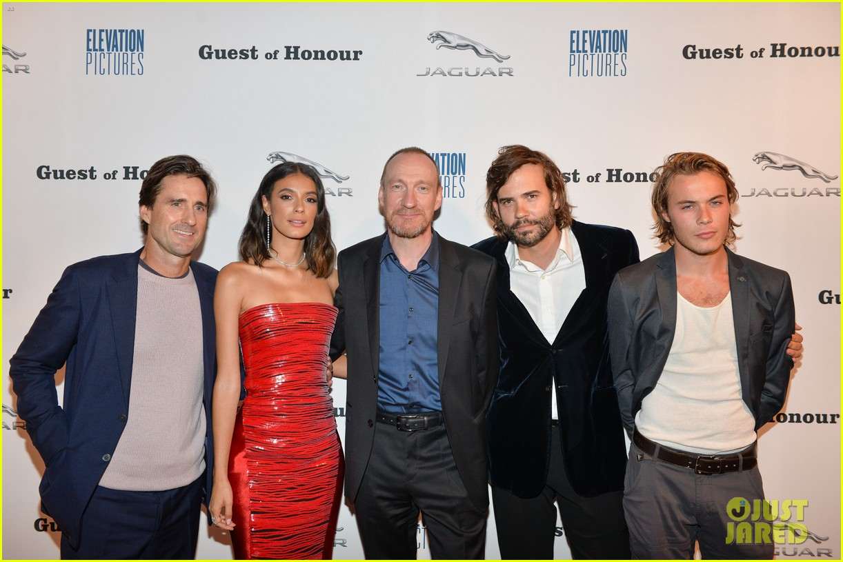 "David Thewlis poses for a photo at the Toronto International Film Festival with ""Guest of Honour"" castmates Luke Wilson, Laysla De Oliveira, Rossif Sutherland, and Alexandre Bourgeois."