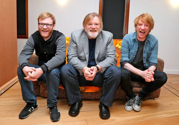 Domhnall Gleeson, far right, is pictured with father Brendan Gleeson and brother Brian Gleeson.