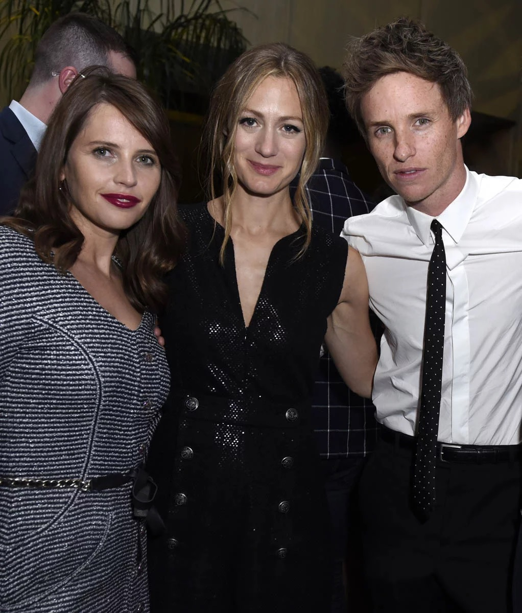 "Eddie Redmayne poses with wife Hannah Bagshawe, center, and ""The Aeronauts"" costar Felicity Jones at the Toronto International Film Festival."