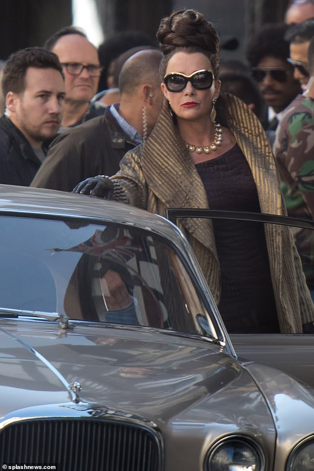 """Dame Emma Thompson looks menacing as she enters a car during filming for """"Cruella"""" last week in London."""