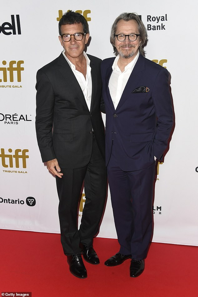 "Gary Oldman and ""The Laundromat"" costar Antonio Banderas share a smile on the red carpet at the Toronto International Film Festival."