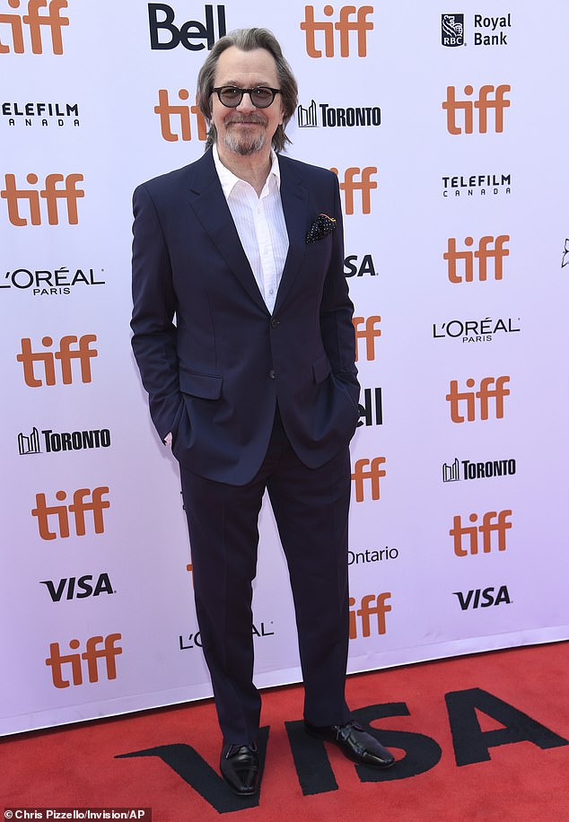 Gary Oldman is the picture of casual style on the red carpet at the Toronto International Film Festival.