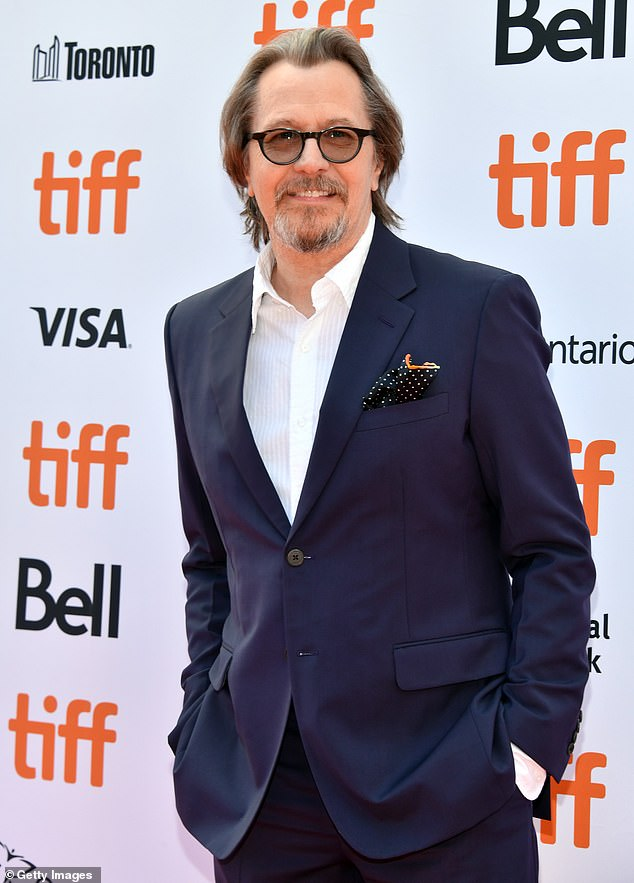 Gary Oldman smiles for the cameras at the Toronto International Film Festival.